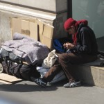 A beggar preparing for the morning.